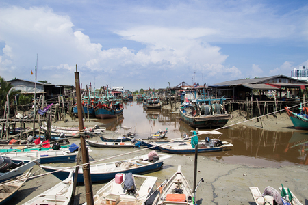 Boats at a Malaysian Chinese fishing village on a river