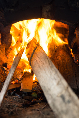the fire in an earth oven.