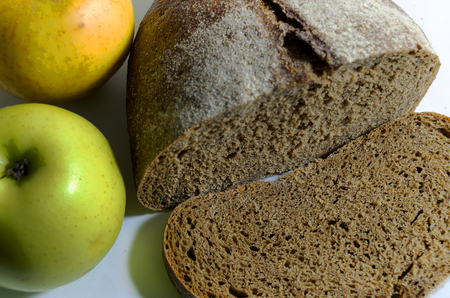 ration: apples black bread on the table