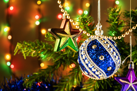 Christmas toy on a tree branch and Garland Stock Photo