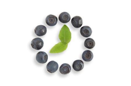 blueberry located as a clock face Stock Photo