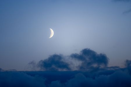 The moon with seen details and edge of a cloud