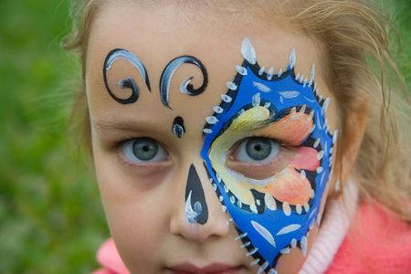 young girl her face painted Stock Photo
