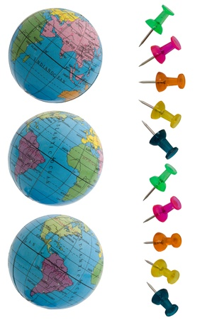 Different plans of the globe and thumbtacked photo