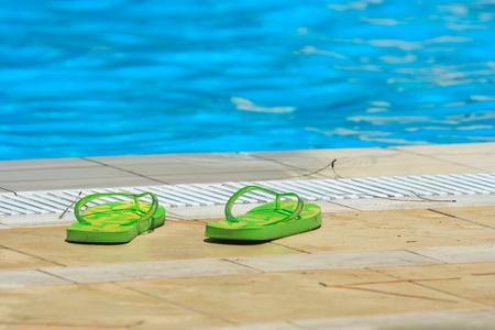 sandals near  swimming pool edge Stock Photo - 10389157