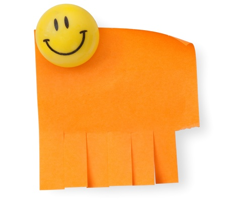 magnetic clip: orange cut paper fixed by a magnetic clip