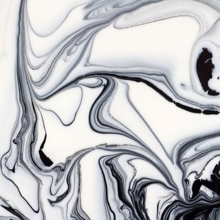 Mix of a white and black paint, closeup  Stock Photo