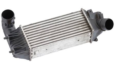 Close up of aluminum automotive intercooler. isolated on white. Stock Photo