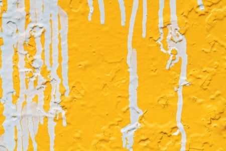streaks of white paint on a yellow wall  photo