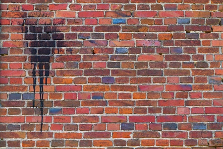 old brick wall with a spot of black paint