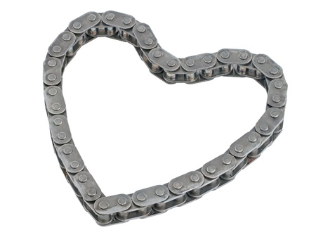 metal chain folded into a heart shape isolated on white photo