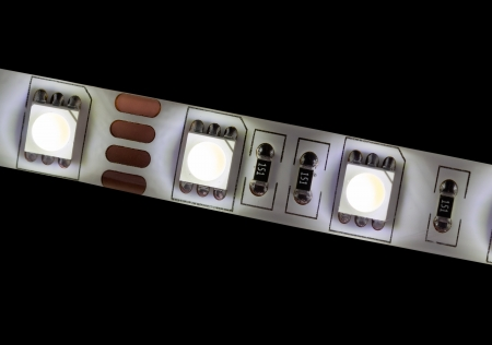 glowing  white LED strip close-up isolated on black photo