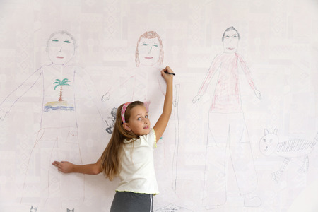Girl draws on the wall my family