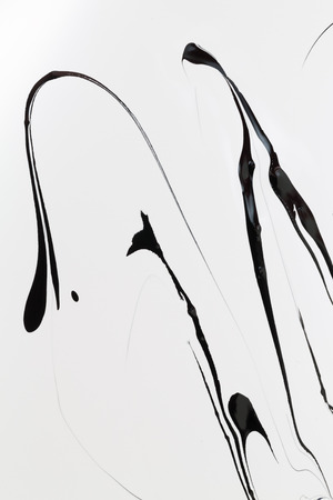 Mix of a white and black paint, closeup. Backgrounds. Stock Photo