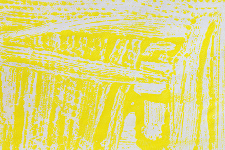 strips yellow paint on paper, macro