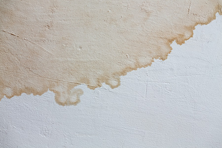traces of stains on the painted white wall Stock Photo