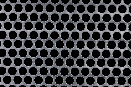 Metal perforated surface, background, texture, isolated on black Stock Photo