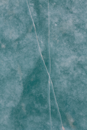 surface of the ice of the frozen lake turquoise color Stock Photo
