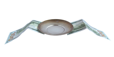 metal saucer with wings in the form of dollar bills, isolated on white