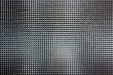 Metal background with square holes. Gray steel texture.