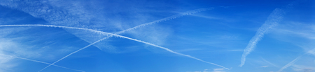 panorama of the sky with intersecting tracks of aircraft