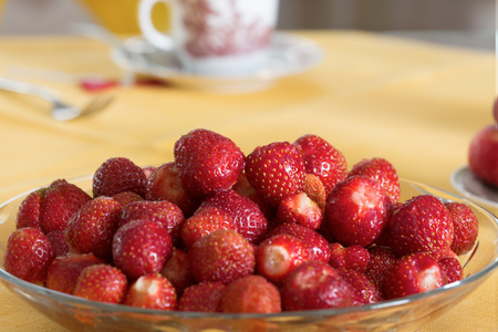 plate of fresh strawberries on a table