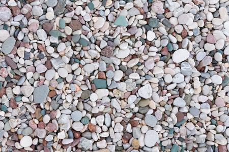 Guijarros de colores en la playa, fondo Foto de archivo