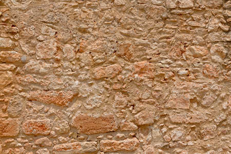 Texture of a wall of an ancient building. From clay and rock.