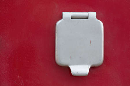 Closed flap Electric socket, on the body of a special car