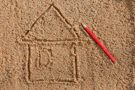 simple drawing of a house on the sand