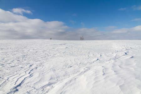 Winter landscape, desert terrain with ground driftsnow