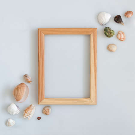 empty wooden photo frame with seashells