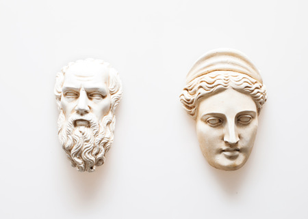 olympian: Heads of Zeus and Hera sculptures