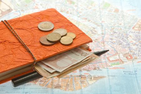 Close-up Travel Arrangement of Euro money, Map and notepad diary Banco de Imagens - 25779829