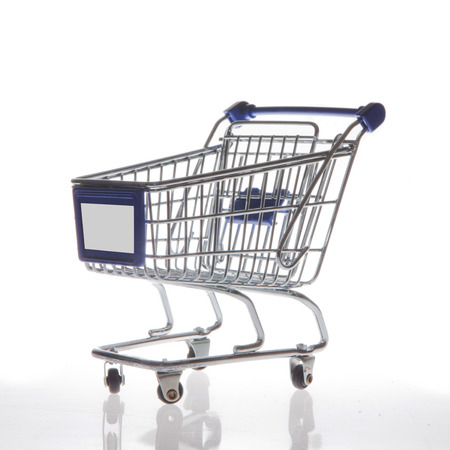 Shopping cart isolated on white side view photo