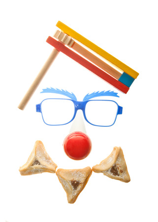 purim: Clown�s face - Purim arrangement with Hamentashen Stock Photo