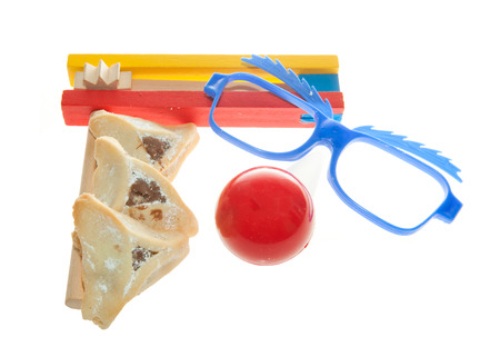 oznei: Purim arrangement with Hamentashen, Gragger, Funny glasses and a red nose Stock Photo
