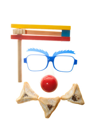oznei: Clown's face - Purim arrangement with Hamentashen Stock Photo