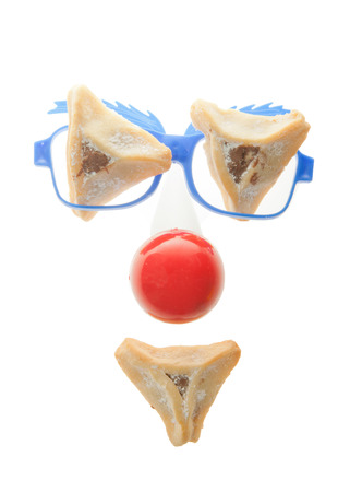 oznei: Clown's face - Purim arrangement with Hamentashen Stock Photo