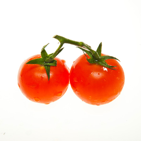 Two red cherry tomato  photo