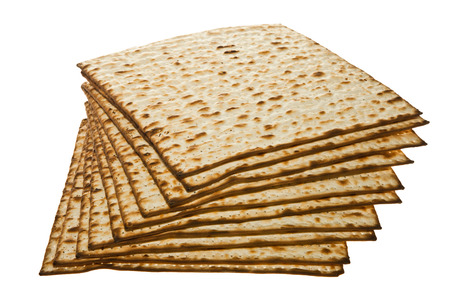 Stack of Matzo isolated on white  photo