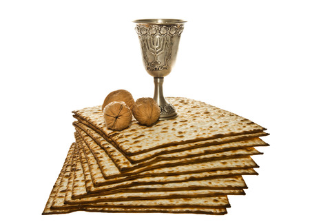 seder: Matzoth, silver Kiddush cup and three walnuts for Passover seder