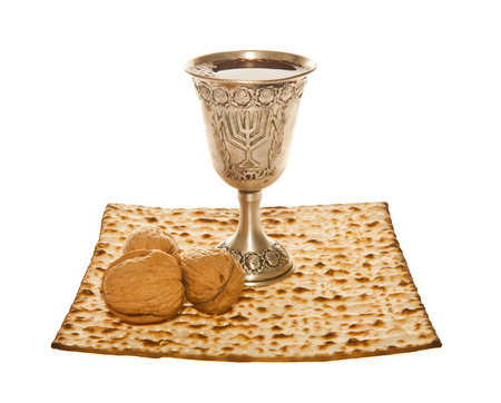 Matzoth, silver Kiddush cup and three walnuts photo