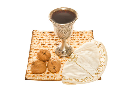 Matzoth, silver Kiddush cup three walnuts and Yarmulke for Passover Seder  photo