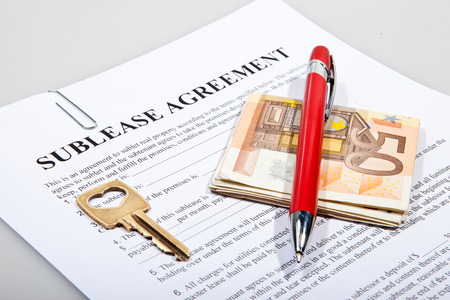 Sublease agreement with Euro notes golden key and pen photo