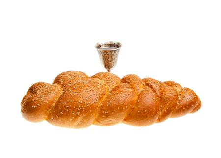 Challah and Silver Kiddush cup for Jewish Sabbath  photo