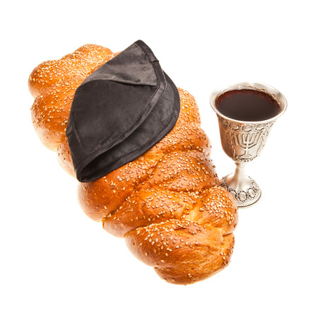 Challah Silver Kiddush cup and Yarmulke for Jewish Sabbath  photo