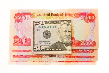 Iraqi Dinars and American Dollar photo