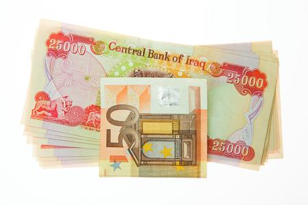 Iraqi Dinars and fifty Euro Note photo