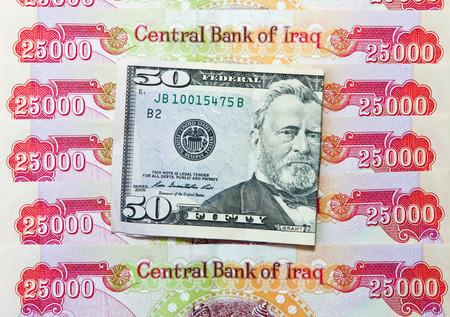 arabic currency: Iraqi Dinars and American Dollar